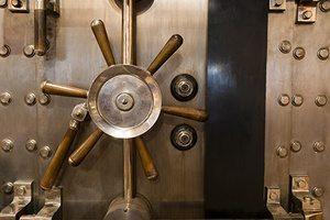 Locked bank vault door in retail store safe secure storage locker